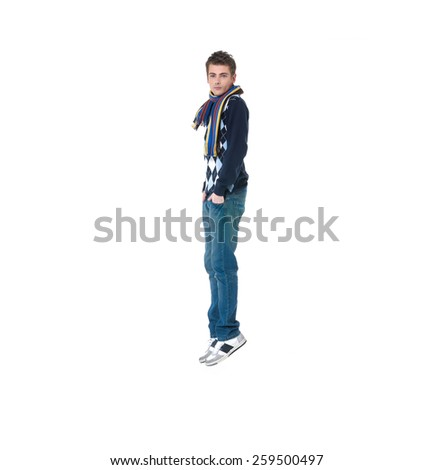 Handsome casual young man jumping on white background  - stock photo