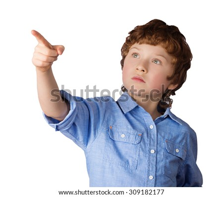 Handsome caucasian boy with red hair points with his finger. Isolated on white background - stock photo