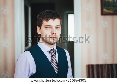 Handsome Caucasian Man In Business Attire Staying In Room - stock photo