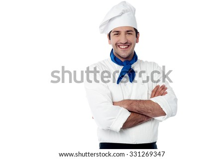 Handsome chef posing against white background - stock photo