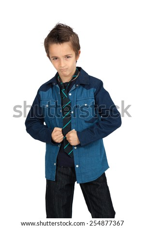 Handsome child doing different expressions in different sets of clothes: angry - stock photo