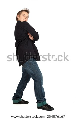 Handsome child doing different expressions in different sets of clothes: Full length posing - stock photo