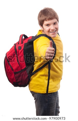Handsome chubby teenage boy with school bag on his back showing thumbs up isolated on white. - stock photo