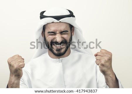 Handsome Confident Arab businessman expressing success, Arabian Businessman, Success Concept   - stock photo