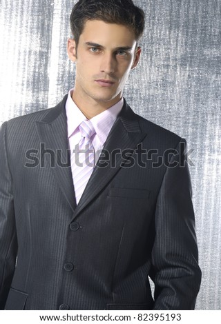 Handsome confident businessman on a gray background - stock photo