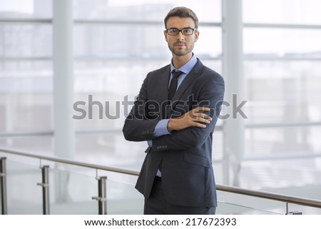 Handsome confident businessman with glasses portrait - stock photo