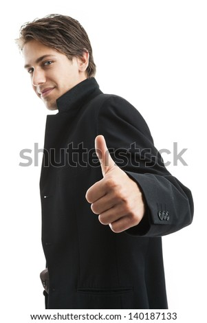 Handsome confident young man giving a thumbs up gesture of success and approval, sideways upper body portrait isolated on white - stock photo