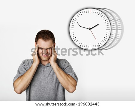 handsome confused man with time problems and delay, concept - stock photo