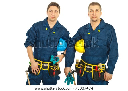Handsome constructors workers men team holding helmets isolatd on white background - stock photo