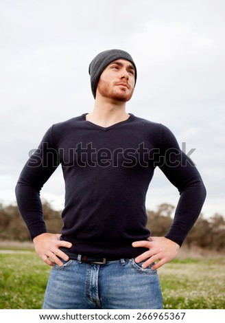 Handsome cool young man with beard and cap wool - stock photo