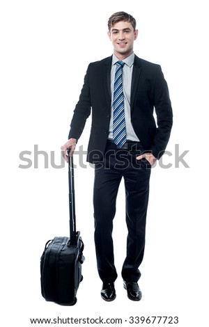 Handsome corporate guy ready for business trip - stock photo