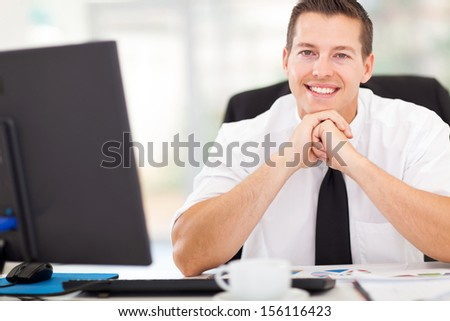 handsome corporate worker looking at the camera - stock photo