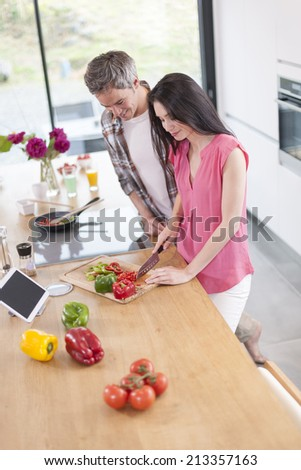 handsome couple cooking  in  kitchen - stock photo