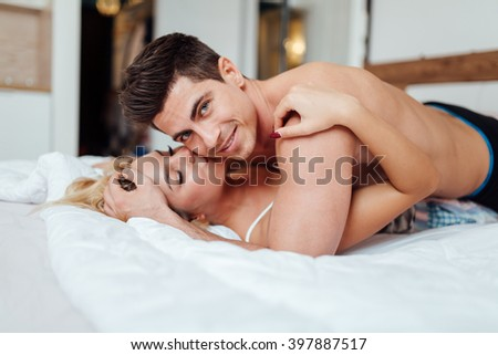 Handsome couple in love in bed being sensual - stock photo