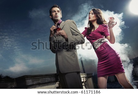 Handsome couple with wine - stock photo