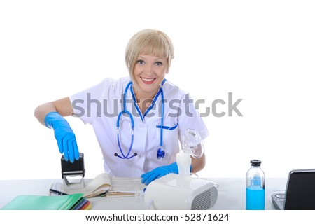 Handsome doctor puts stamp. Isolated on white background - stock photo
