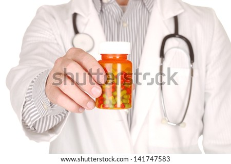 Handsome Doctor With Medication in Prescription Bottles - stock photo