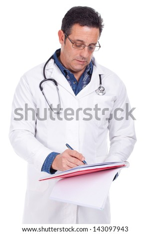 Handsome doctor writing prescription looking at you - stock photo