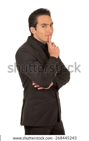 handsome elegant young latin man wearing a suit posing gesturing silence isolated on white - stock photo