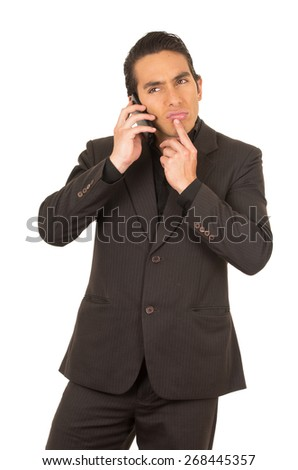 handsome elegant young latin man wearing a suit posing talking on cell phone mobile isolated on white - stock photo