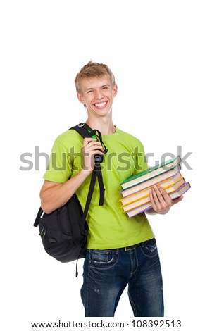 handsome excited man happy smile looking at camera holding stack pile of books, young guy wear green t shirt and school bag, isolated over white background concept of study, knowledge, learn for exam - stock photo