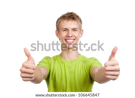 handsome excited man happy smile show thumb up gesture at you, young guy wear green t shirt, white teeth, isolated over white background - stock photo