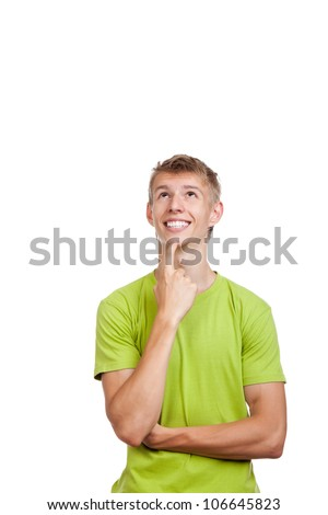 handsome excited man happy smile think looking up to empty copy space,young guy wear green t shirt, white teeth, isolated over white background - stock photo