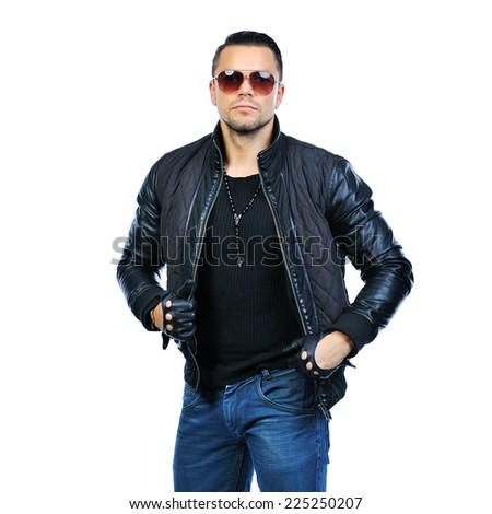 Handsome fashion man wearing jacket and sunglasses - stock photo