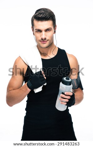 Handsome fitness man holding towel and bottle with water isolated on a white background. Looking at camera - stock photo