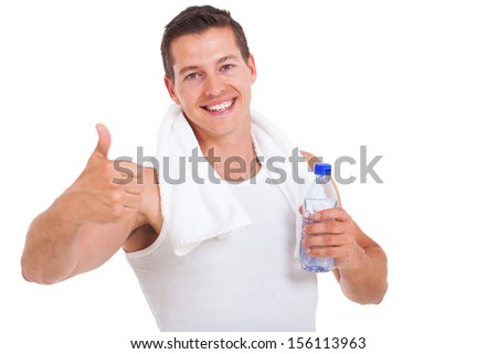 handsome fitness man holding water bottle and giving thumb up isolated on white background - stock photo
