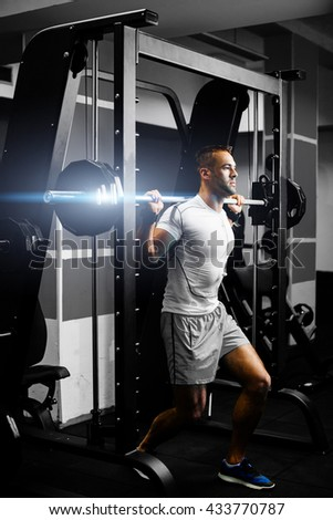 handsome fitness man weightlifting workout in gym - stock photo