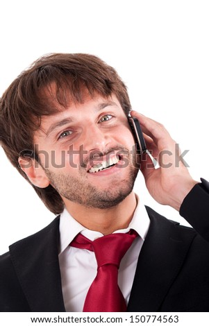 Handsome friendly businessman using a cell phone - stock photo