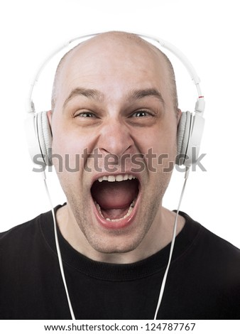 Handsome guy in the stereo headphone shouting isolated on a white background - stock photo