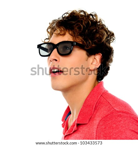 Handsome guy looking away through his sunglasses - stock photo