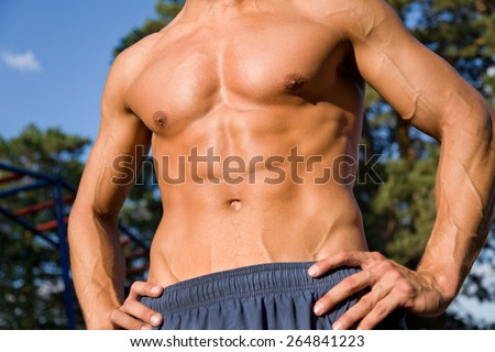 handsome guy with muscular body in training - stock photo