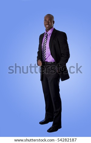 Handsome happy African American corporate business man smiling, wearing black suit with purple shirt, standing with authority with hand in pocket,  isolated. - stock photo