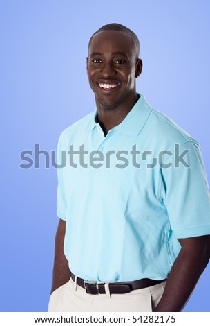 Handsome happy African American corporate business man smiling, wearing blue polo shirt, hands in pocket, standing, isolated. - stock photo