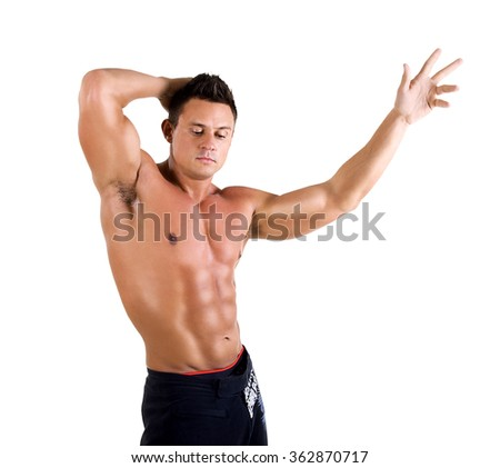 Handsome Healthy young man with muscular torso posing smiling. Isolated on white background 