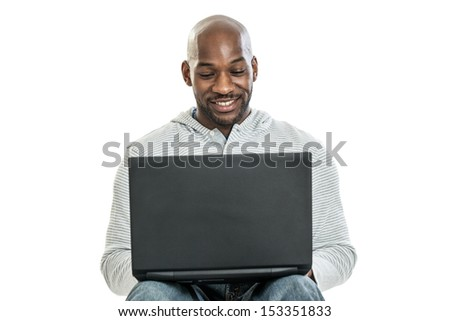 Handsome late 20s black man typing on the computer isolated on a white background - stock photo