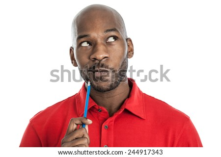 Handsome late 20s black man with pencil on chin thinking isolated on a white background - stock photo