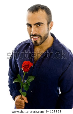 Handsome latin man holding a rose - stock photo