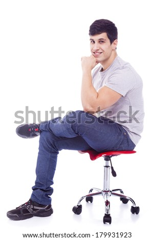 Handsome latin man sitting on a chair, isolated over a white background - stock photo
