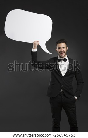 Handsome latino young man holding a speach balloon - stock photo