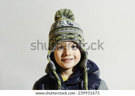 handsome little boy.funny smiling child.winter fashion kids.fashionable boy in winter cap - stock photo