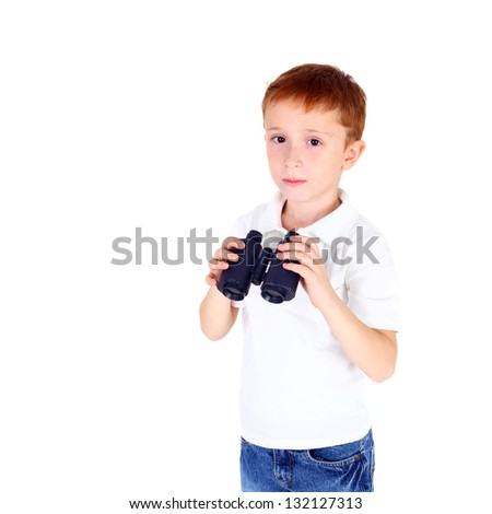 handsome little boy with the binocular - stock photo
