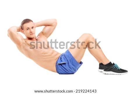 Handsome male athlete exercising on the floor isolated on white background - stock photo