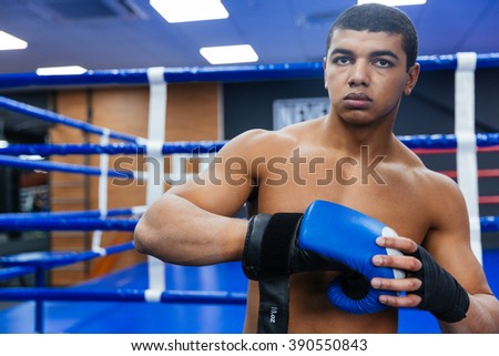 Handsome male boxer getting ready for fight - stock photo
