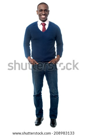 Handsome male business executive, hands in pockets - stock photo