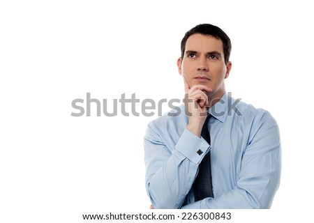 Handsome male executive thinking about something - stock photo