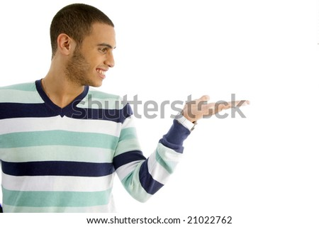 handsome male holding something with hand gesture against white background - stock photo
